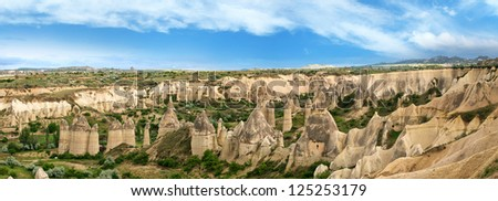 Panoramic view of Unique geological formations in the Cappadocia, Turkey - stock photo