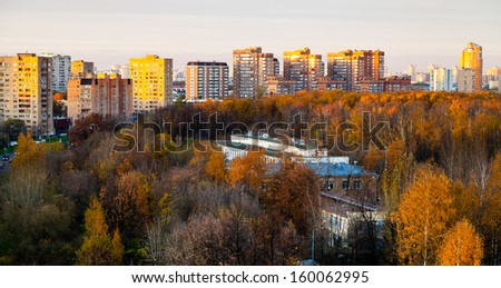 panoramic view of urban residential district in pink autumn sunset - stock photo