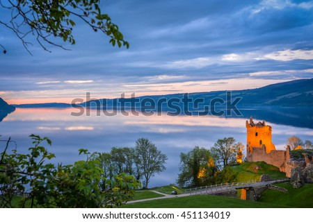 Panoramic view of Urquhart Castle. The castle sits beside Loch Ness, near Inverness and Drumnadrochit, in the Highlands of Scotland. Only the tower of the castle is in focus; the rest is blur. - stock photo