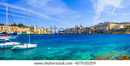 panoramic view of Valetta with sailing boats in turquoise sea. Malta