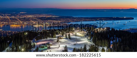 Panoramic View of Vancouver city, british columbia, Canada, from the summit of Grouse Mountain ski resort at Dusk - stock photo