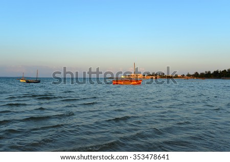 Panoramic View of Vilanculos Beach in Mozambique during high tide at sunset. - stock photo
