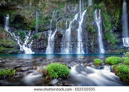 Panoramic view of waterfall on river Langevin in tropical jungle, Reunion Island. - stock photo