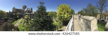 Panoramic view of York Minster and the city wall in the city of York in northeast England - stock photo