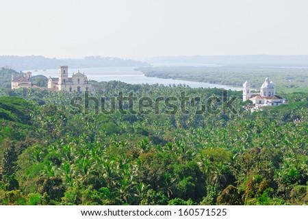 Panoramic view Old Goa. Mandovi river and ancient Churches - stock photo