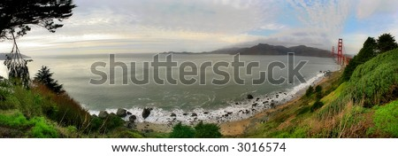 Panoramic view on Baker Beach, Pacific Ocean and Golden Gate Bridge from Presidio of San Francisco park. - stock photo