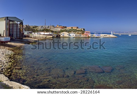 panoramic view on beach of sea with ships - stock photo