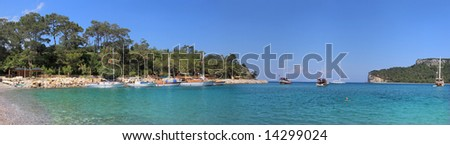 "Panoramic view on beautiful bay in Kemer, Turkey known also as ""Moonlight Beach"". - stock photo"