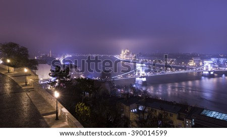 Panoramic View On Budapest At Night, Hungary, View On The Chain Bridge and the Parliament