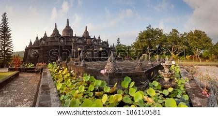 Panoramic view on budhist temple Brahma Vihara-Arama Banjar to Lovina, Indonesia, Bali, small version of Borobudur temple on Java - stock photo