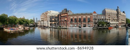 Panoramic view on canal (Amstel river) and city center of Amsterdam, Netherlands.