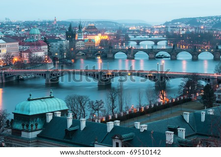 Panoramic view on Charles bridge and evening Prague lights.  Beautiful famous place in Bohemia. - stock photo