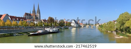 Panoramic view on Danube river in Regensburg with Regensburg Cathedral, Tower of Town Hall, Salt House and Stone Bridge, Germany - stock photo