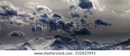 Panoramic view on evening mountains and cloudy sky. Caucasus Mountains. Georgia, view from ski resort Gudauri.
