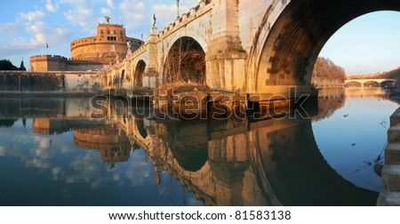 Panoramic view on famous Saint Angel Castle and bridge over the Tiber river in Rome, Italy. - stock photo