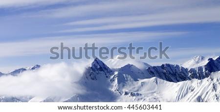 Panoramic view on high mountains in haze. Caucasus Mountains, Georgia, region Gudauri. - stock photo