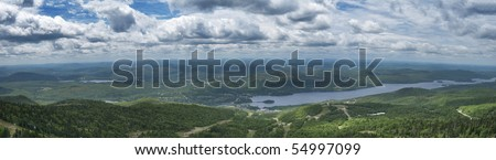 Panoramic view on Mont Tremblant Ski Resort village and the surroundings. - stock photo