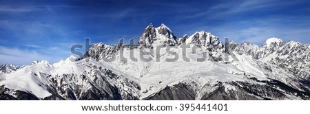 Panoramic view on Mount Ushba at wind sunny day. Caucasus Mountains. Svaneti region of Georgia.  - stock photo