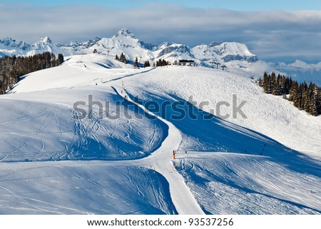 Panoramic View on Mountains and Skiing and Snowboarding in French Alps
