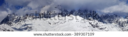 Panoramic view on Mounts Ushba and Chatyn in haze at sunny day. Caucasus Mountains. Svaneti region of Georgia. - stock photo