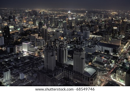panoramic view on nice big city at night - stock photo