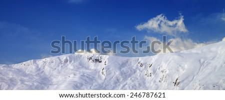 Panoramic view on off-piste slope in early morning. Caucasus Mountains, Georgia, ski resort Gudauri. - stock photo