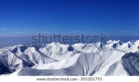 Panoramic view on off-piste slopes and multicolor blue sky at nice sunny day. Caucasus Mountains, Georgia, ski resort Gudauri. - stock photo