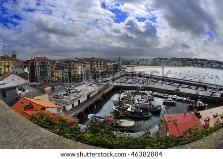 Panoramic view on old port of San Sebastian, Spain - stock photo