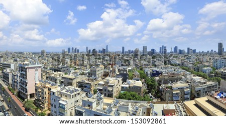 Panoramic view on roofs of old Tel-Aviv (Israel) on the modern buildings background   - stock photo