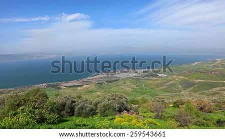 Panoramic view on Sea of Galilee - Kinneret (Lake Tiberias - is the largest freshwater lake in Israel) and agricultural valley. View from from Galilee Mountains. Golan Heights. Israel - stock photo