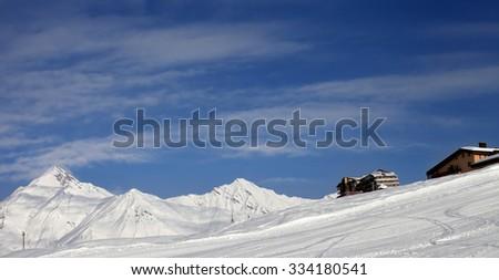 Panoramic view on ski slope and hotels in winter mountains. Caucasus Mountains, Georgia. Ski resort Gudauri. - stock photo