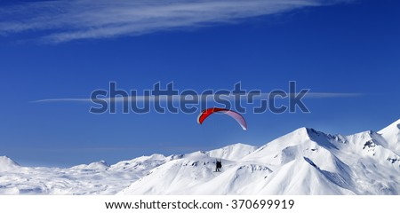 Panoramic view on sky gliding in snowy mountains at nice sun day. Caucasus, Georgia, region Gudauri. - stock photo