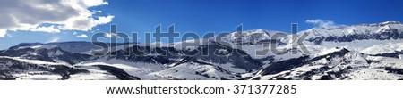 Panoramic view on snowy mountains at nice sun day. Greater Caucasus, Shahdagh. Qusar rayon of Azerbaijan. - stock photo
