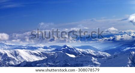 Panoramic view on sunlight snowy mountains. Caucasus Mountains, Georgia. Ski resort Gudauri. - stock photo