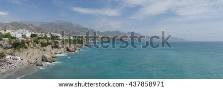 Panoramic view on the coast of Nerja as seen from balcon de Europa. Costa del Sol. Malaga, Andalusia, Spain - stock photo