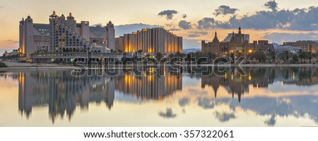 Panoramic view on tropical lagoon in Eilat at night - stock photo