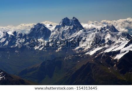Panoramic view on Ushba mountain from Elbrus - stock photo