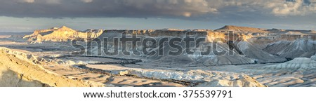 Panoramic view on valley of the dry spring (wadi) Tzin in National nature park Ein Avdat in desert of the Negev, Israel - stock photo