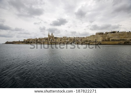 Panoramic view over Malta's capital Valletta against a cloudy sky. - stock photo