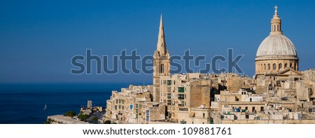 Panoramic view over Maltas capital Valletta against the blue sky and deep blue sea - stock photo