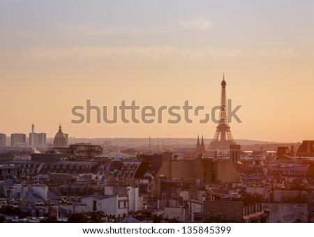 Panoramic view over Paris with Eiffel Tower and clear sky from Pompidou center at sunset - stock photo