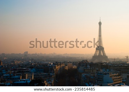 Panoramic view over Paris with Eiffel Tower and clear sky from The Triumphal Arch at sunset - stock photo