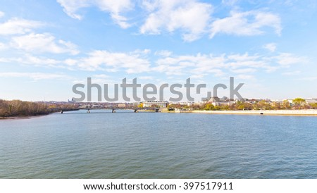 Panoramic view over Potomac river in Washington DC. Key Bridge and Kennedy Center for the Performing Arts in spring. - stock photo