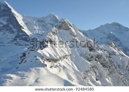 Panoramic view over the alps in switzerland from helicopter - stock photo