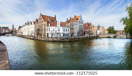 Panoramic view over the Canal, houses and bridges in Brugge - stock photo