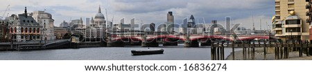 Panoramic view over the River Thames looking towards Blackfriar's Bridge, with St Paul's Cathedral - stock photo