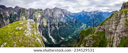 Panoramic view over valley in Julian Alps - stock photo