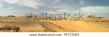 Panoramic view. Sandy and deserted landscape in the Libyan desert.