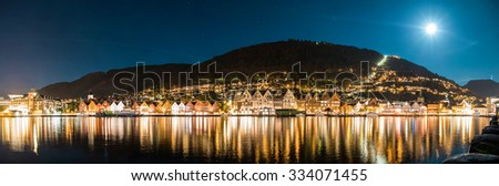 Panoramic view to Bergen city, famous Bryggen buildings and Floen mountain in Norway in moonlit night - UNESCO world heritage site - stock photo