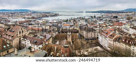 Panoramic view to historical center of Geneva city and Lake Leman, Switzerland, from Saint-Pierre cathedral in cloudy day at winter - stock photo